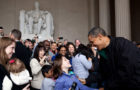 """After the President and Congress finally agreed on a bill to keep the government from shutting down, the President decided to make an unannounced stop to thank tourists for visiting the Lincoln Memorial the following day. The Memorial and other monuments and national parks in Washington and across the country would have been forced to close had they not come to an agreement. Here, the President greets a surprised young girl as other tourists in the background snap pictures of their chance encounter with the President."" (Official White House Photo by Pete Souza)"