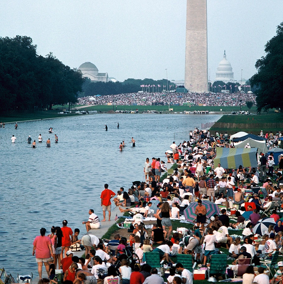 On the Fourth of July, Americans come together on the Mall to celebrate our country's birthday with picnics, musical performances, and fireworks launched against the backdrop of the iconic monuments (Photo courtesy Tom Wachs)