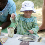 A young attendee learns about Malian art at the 2011 Smithsonian Folklife Festival. (Peace Corps)