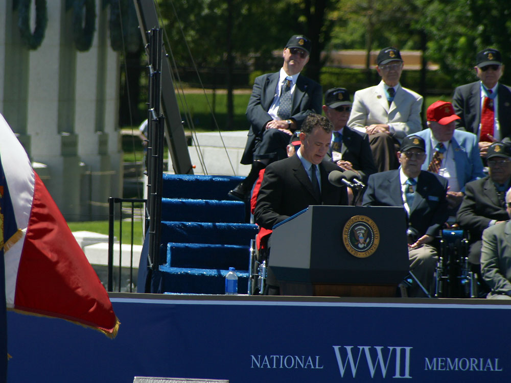 Actor Tom Hanks at the World War II Memorial dedication in Washington D.C. Photo credit: Don Ripper (Latoff Inc.) / American Battle Monuments Commission from the National World War II Memorial website (https://www.wwiimemorial.com).