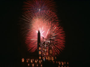July 4th fireworks highlight the Washington Monument and the Smithsonian Folklife Festival's Philippines Chapel in 1998.